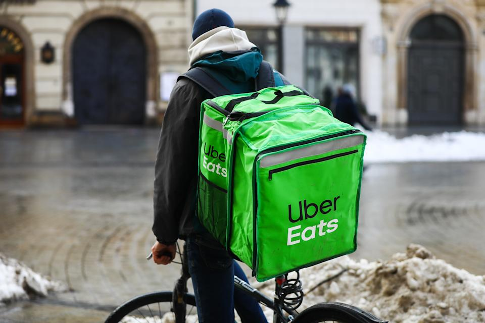 Uber Eats delivery courier is seen riding a bicycle in the center of Krakow, Poland. January 20th, 2021. As restaurants remain closed in Poland due to the coronavirus pandemic lockdown, ordering food online has bacame extremely popular in large cities.  (Photo by Beata Zawrzel/NurPhoto via Getty Images)