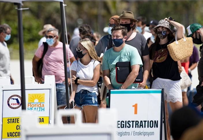 People line up to receive a Johnson & Johnson vaccine in Miami Beach on May 2, 2021.