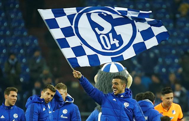 Soccer Football - Bundesliga - Schalke 04 vs TSG 1899 Hoffenheim - Veltins-Arena, Gelsenkirchen, Germany - February 17, 2018 Schalke's Franco Di Santo celebrates with a flag after the match REUTERS/Leon Kuegeler DFL RULES TO LIMIT THE ONLINE USAGE DURING MATCH TIME TO 15 PICTURES PER GAME. IMAGE SEQUENCES TO SIMULATE VIDEO IS NOT ALLOWED AT ANY TIME. FOR FURTHER QUERIES PLEASE CONTACT DFL DIRECTLY AT + 49 69 650050