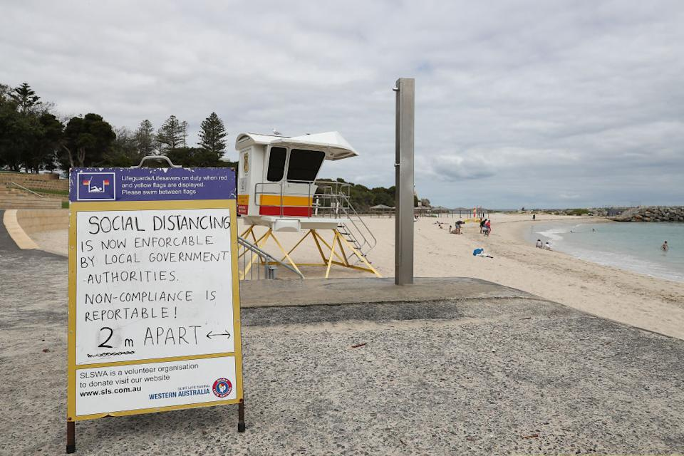 Social distancing signage is seen at Cottesloe Beach in Perth. Source: Getty