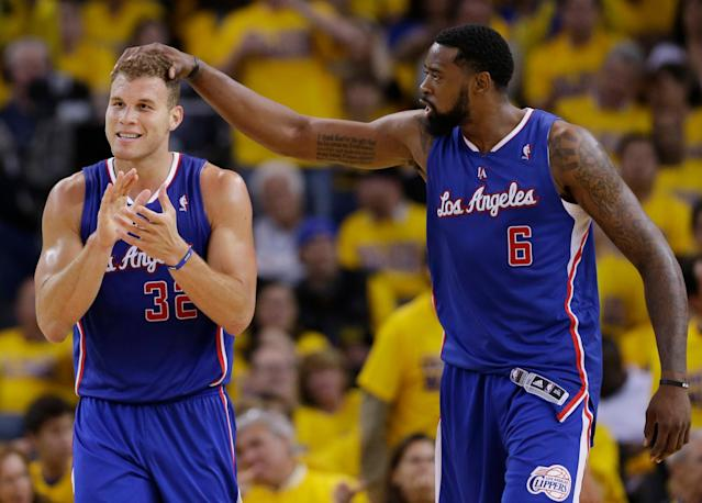 Los Angeles Clippers' Blake Griffin (32) celebrates with teammate DeAndre Jordan (6) after Griffin drew a fragrant foul during the second half in Game 3 of an opening-round NBA basketball playoff series against the Golden State Warriors on Thursday, April 24, 2014, in Oakland, Calif. Los Angeles won 98-96. (AP Photo/Marcio Jose Sanchez)