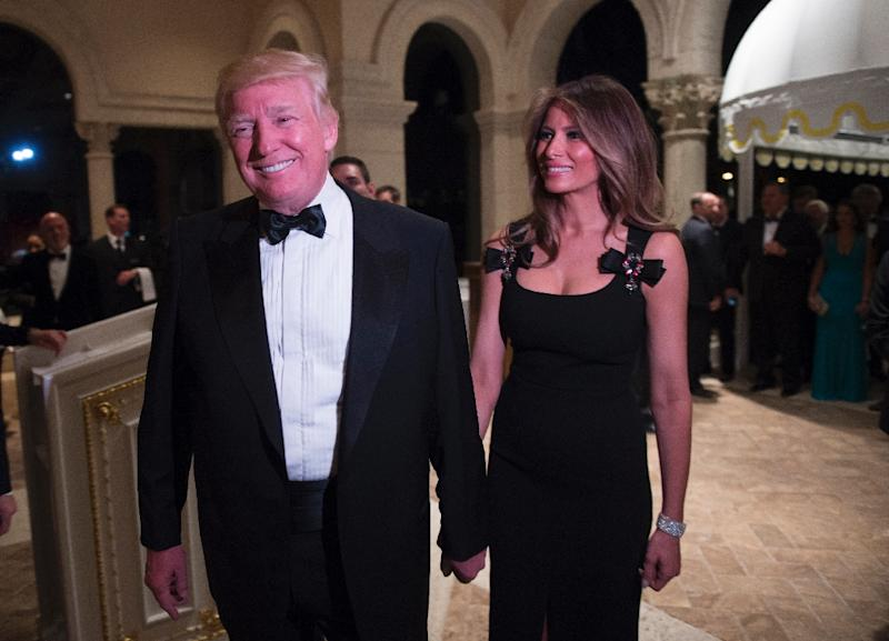 US President-elect Donald Trump arrives with his wife Melania for a New Year's Eve party at Mar-a-Lago in Palm Beach, Florida, on December 31, 2016 (AFP Photo/DON EMMERT)