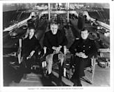 <p>Barbara Bach and Roger Moore sitting in front of a submarine tank at Pinewood Studios with producer Albert R. Broccoli between them, during the making of the James Bond film 'The Spy Who Loved Me', 1977.</p>