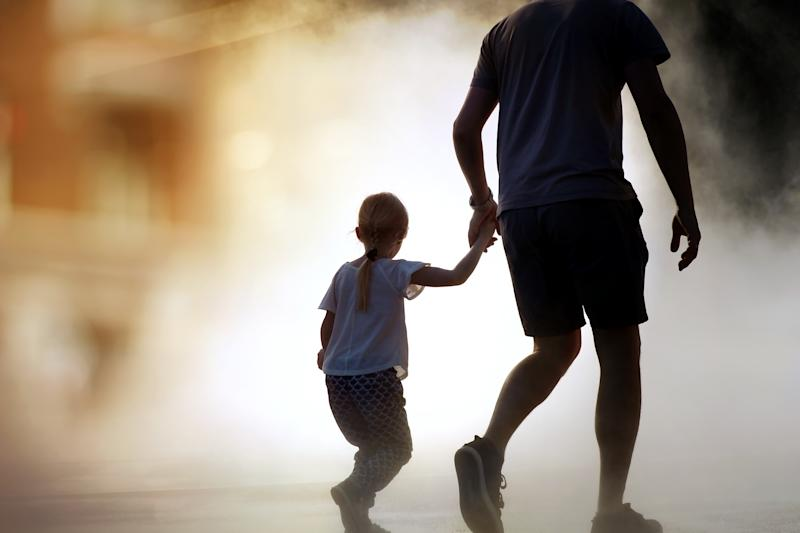 man runing / rescue wiith child from fire