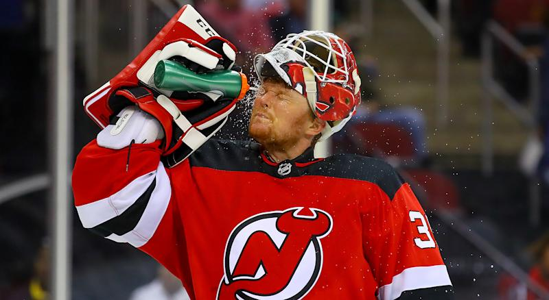 NEWARK, NJ - OCTOBER 14: New Jersey Devils goaltender Cory Schneider (35) sprays water on his face during the third period of the National Hockey League game between the New Jersey Devils and the Florida Panthers on October 14, 2019 at the Prudential Center in Newark, NJ. (Photo by Rich Graessle/Icon Sportswire via Getty Images)