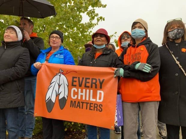 'It fills my heart to see a sea of orange out there,' said Kwanlin Dün elder Jessie Dawson on Thursday, as hundreds of people gathered in downtown Whitehorse to mark the National Day for Truth and Reconciliation. (Maya Lach-Aidelbaum/CBC - image credit)