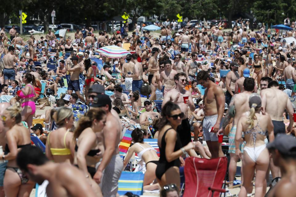Crowds gather on L Street Beach, Saturday, June 5, 2021, in the South Boston neighborhood of Boston. New England is giving the rest of the country a possible glimpse into the future if more Americans get vaccinated. The six-state region has among the highest vaccination rates in the U.S. and is seeing sustained drops in COVID-19 cases, hospitalizations and deaths. (AP Photo/Michael Dwyer)