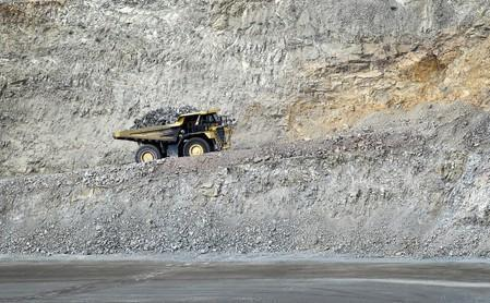 FILE PHOTO: Heavy mining equipment hauls overburden material across Molycorp's Mountain Pass Rare Earth facility in Mountain Pass, California