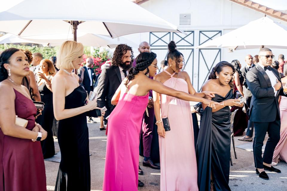 We created a beautiful space for our guests to connect before the ceremony started. Here, my Sisters of Honor Christina Elmore and Kylie Bunbury are reacting to our song-themed seating chart wall!