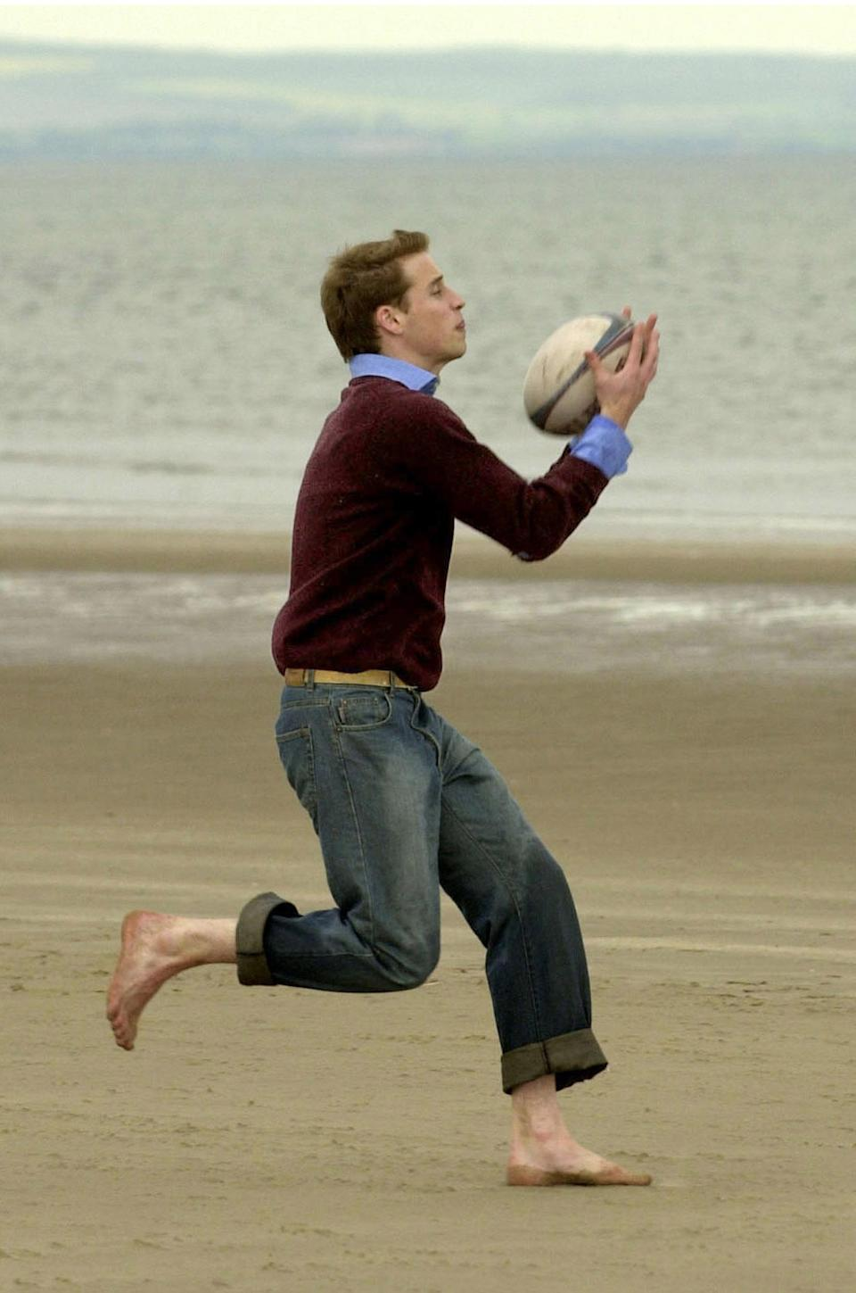 <p>Prince William catching a rugby ball on the beach at St Andrews. He and Kate will return to the beach during their week-long tour as they revisit their student days. (PA Images)</p>