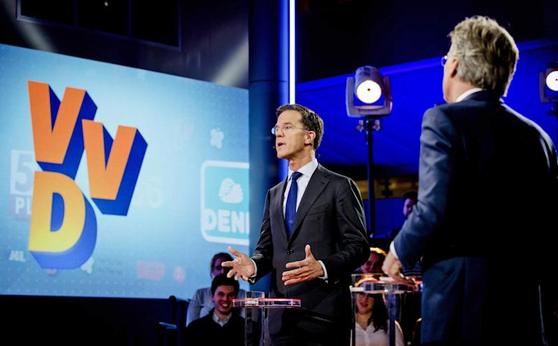 Dutch Prime Minister Mark Rutte, second right, gestures during the closing debate at parliament in The Hague, Netherlands, Tuesday, March 14, 2017. Amid unprecedented international attention, the Dutch go to the polls Wednesday in a parliamentary election that is seen as a bellwether for the future of populism in a year of crucial votes in Europe. (Robin van Lonkhuijsen ANP POOL via AP)