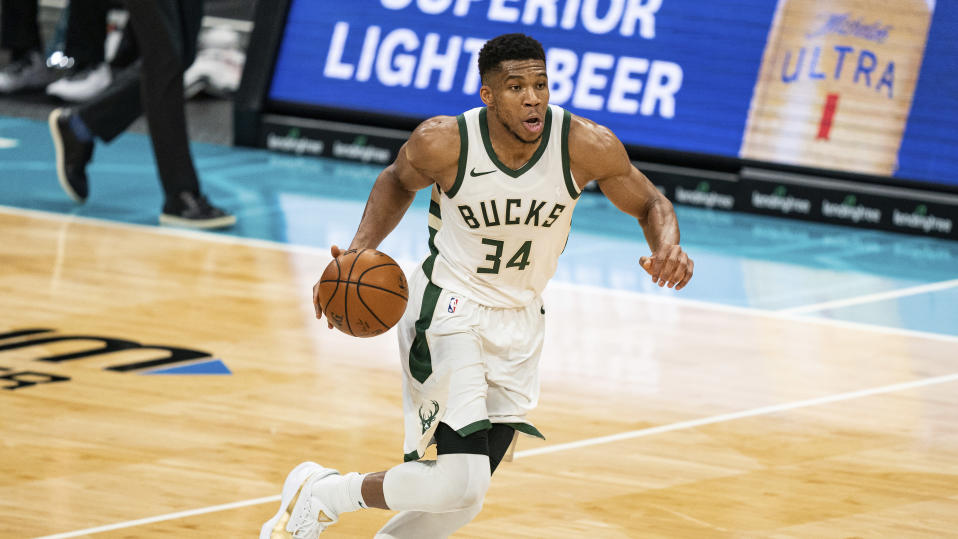 Milwaukee Bucks forward Giannis Antetokounmpo (34) brings the ball up court against the Charlotte Hornets during an NBA basketball game in Charlotte, N.C., Saturday, Jan. 30, 2021. (AP Photo/Jacob Kupferman)