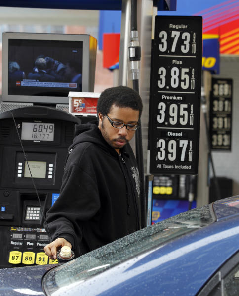 Michael Morris prepares to put gas in his car Friday, Feb. 24, 2012 in Philadelphia. The price of gasoline, which is made from crude oil, has soared as oil prices rise. The national average jumped by nearly 12 cents per gallon in a week, with state averages above $4 per gallon in California, Alaska and Hawaii. (AP Photo/Alex Brandon)