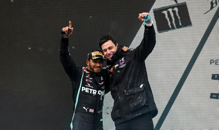 Mercedes' driver Lewis Hamilton (left) and Team Principal Toto Wolff (right)have formed a formidable partnership