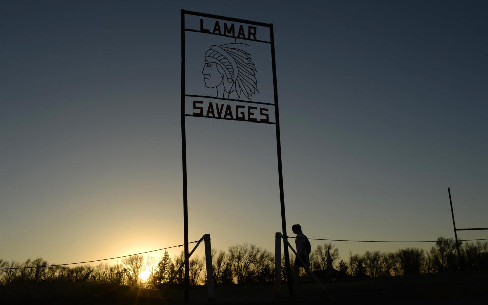 FILE — Alina Balasoiu, a student at Lamar High School, walks back to school after playing in a soccer game in the fields behind the school in this file photograph taken March 31, 2015. Colorado lawmakers are considering a proposal to ban Native American mascots in public schools and colleges. the state Senate Education Committee is scheduled to discuss a measure Thursday, April 1, 2021 that would impose a $25,000 monthly fine on public schools, colleges and universities that continue to use an American Indian-themed mascot after June 1, 2022. (RJ Sangosti/The Denver Post via The AP)