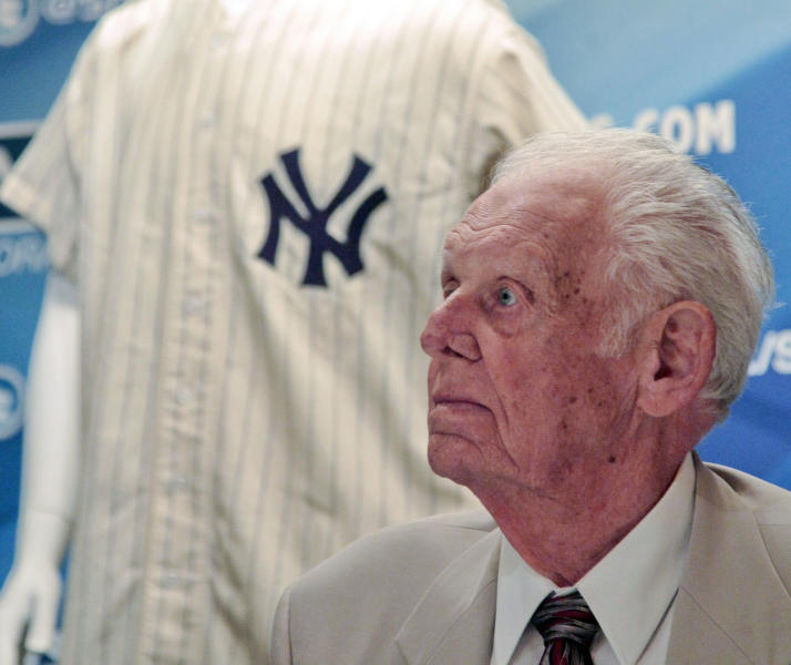 FILE - In this June 28, 2012, file photo, New York Yankees great Don Larsen reacts during a news conference announcing the auction of his 1956 perfect game uniform in New York. Larsen is auctioning off the Yankee pinstripes he wore in 1956 when he pitched the only perfect game in World Series history, and will use the proceeds to pay college tuition for his grandchildren, one in college and the other a high school freshman. (AP Photo/Bebeto Matthews, File)