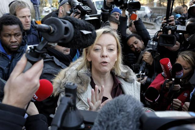 Michael Schumacher's manager Sabine Khem, center, speaks to journalists Wednesday, Jan. 1, 2014, in front of the Grenoble hospital, French Alps, where former seven-time Formula One champion Michael Schumacher is being treated after sustaining a head injury during a ski accident Sunday. (AP Photo/Laurent Cipriani)