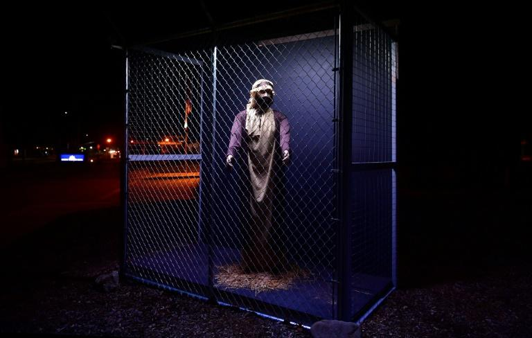 The Christmas Nativity scene at the Claremont United Methodist Church in Claremont, California Jesus, Mary and Joseph as caged refugees to protest the conditions faced by migrants seeking to stay in the United States (AFP Photo/Frederic J. BROWN)