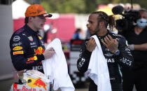 Mercedes driver Lewis Hamilton of Britain talks with second placed Red Bull driver Max Verstappen of the Netherlands, left, after winning the Spanish Formula One Grand Prix at the Barcelona Catalunya racetrack in Montmelo, just outside Barcelona, Spain, Sunday, May 9, 2021. (AP Photo/Emilio Morenatti, Pool)