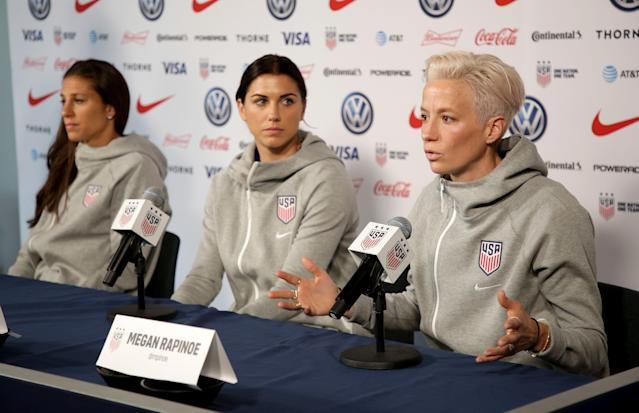 Megan Rapinoe, right, and Alex Morgan, center, said they won't go to the White House. (AP Photo/Seth Wenig)