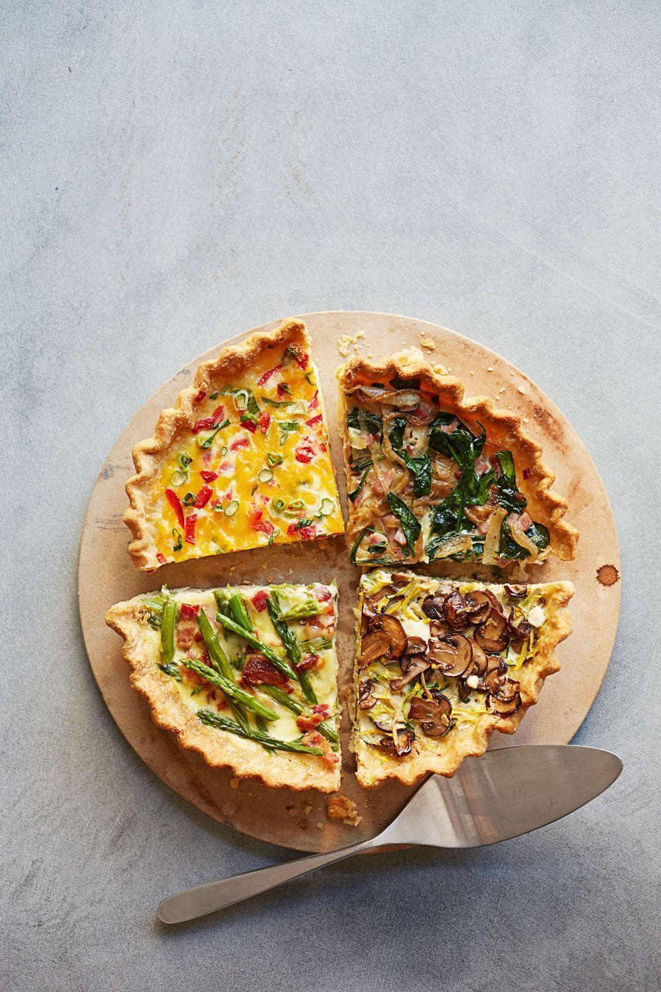 """<p>Quiches are the best way to mix and match your favorite ingredients. Need inspiration? Look no further.</p><p><em><a href=""""https://www.goodhousekeeping.com/food-recipes/a11866/ham-spinach-make-ahead-quiche-recipe-ghk0514/"""" rel=""""nofollow noopener"""" target=""""_blank"""" data-ylk=""""slk:Get the recipe for Ham and Spinach Make-Ahead Quiche»"""" class=""""link rapid-noclick-resp"""">Get the recipe for Ham and Spinach Make-Ahead Quiche»</a></em></p><p><em><a href=""""https://www.goodhousekeeping.com/food-recipes/a14620/asparagus-bacon-make-ahead-quiche-recipe-ghk0514/"""" rel=""""nofollow noopener"""" target=""""_blank"""" data-ylk=""""slk:Get the recipe for Asparagus and Bacon Make-Ahead Quiche »"""" class=""""link rapid-noclick-resp"""">Get the recipe for Asparagus and Bacon Make-Ahead Quiche »</a></em></p><p><em><a href=""""https://www.goodhousekeeping.com/food-recipes/a15630/pimiento-cheese-make-ahead-quiche-recipe-ghk0514/"""" rel=""""nofollow noopener"""" target=""""_blank"""" data-ylk=""""slk:Get the recipe for Pimiento Cheese Make-Ahead Quiche»"""" class=""""link rapid-noclick-resp"""">Get the recipe for Pimiento Cheese Make-Ahead Quiche»</a></em></p><p><a href=""""https://www.goodhousekeeping.com/food-recipes/a14636/mushroom-zucchini-make-ahead-quiche-recipe-ghk0514/"""" rel=""""nofollow noopener"""" target=""""_blank"""" data-ylk=""""slk:Get the recipe for Mushroom and Zucchini Make-Ahead Quiche »"""" class=""""link rapid-noclick-resp""""><em>Get the recipe for Mushroom and Zucchini Make-Ahead Quiche »</em></a></p>"""
