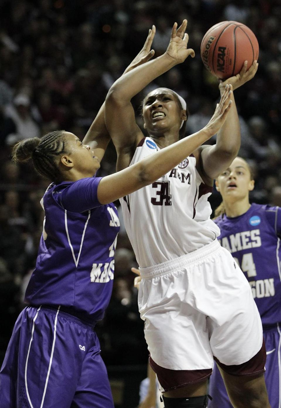 3Texas A&M center Karla Gilbert (34) takes a shot over James Madison forward Da'Lishia Griffin during the first half of an NCAA women's basketball game, Tuesday, March 25, 2014, in College Station, Texas. (AP Photo/Patric Schneider)