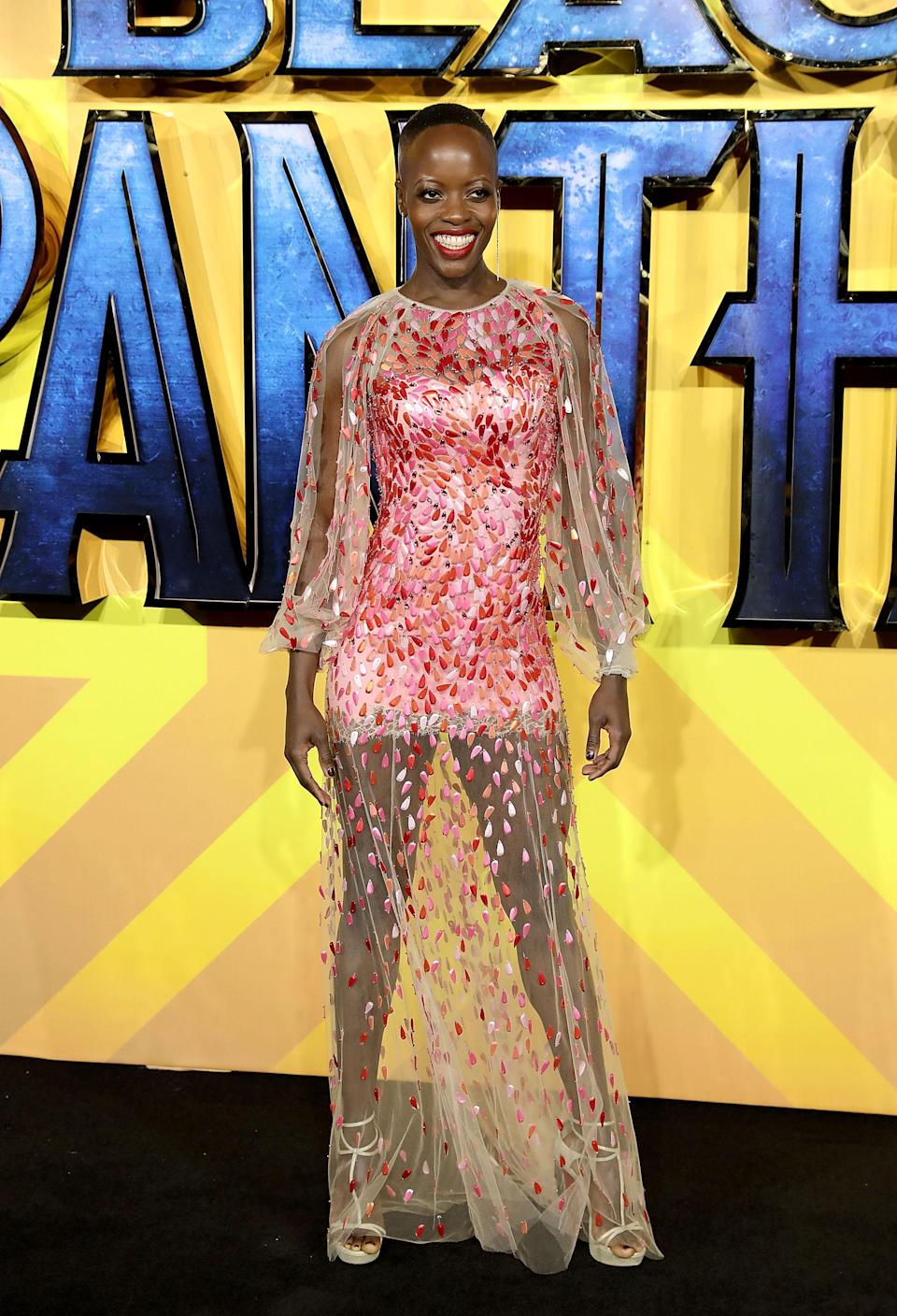 <p>The German-Ugandan actress added a touch of spring to the red carpet in a pink mini dress with a floral overlay. <em>[Photo: Getty] </em> </p>