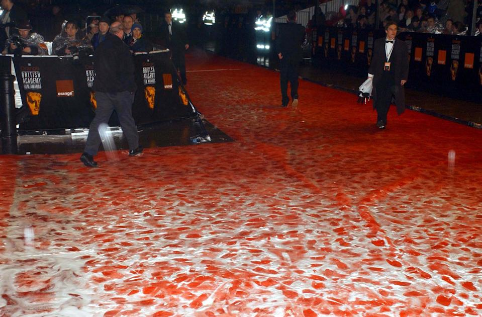 The stars of the big screen leave their footprints on a very wet  red carpet after their arrived for the Orange British Academy Film Awards at the Odeon cinema in London's Leicester Square.   (Photo by Yui Mok - PA Images/PA Images via Getty Images)