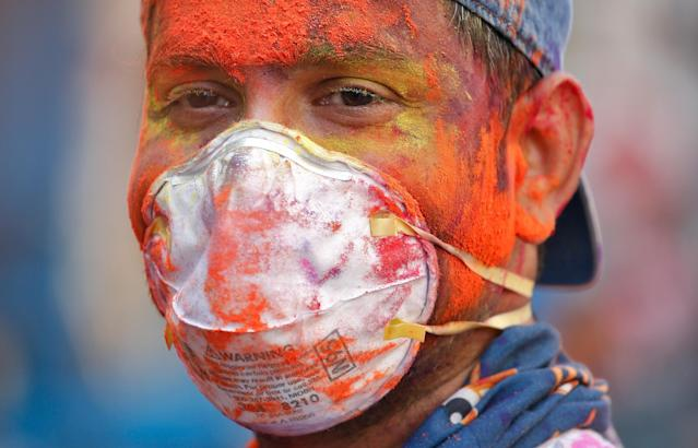 A man wearing protective mask attends Holi celebrations amid coronavirus precautions, in Chennai, India, March 10, 2020. REUTERS/P. Ravikumar