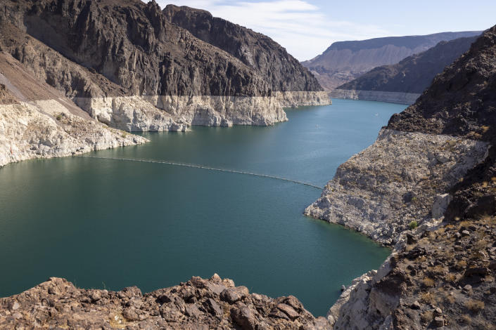 """BOULDER CITY, NV - JULY 1: The white """"bathtub ring"""" around Lake Mead shows the record low water level as drought continues to worsen on July 1 near Boulder City, Nev. (David McNew/Getty Images)"""