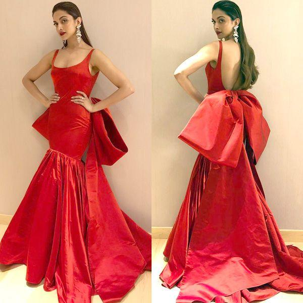 <p>Deepika looks like a gift, wrapped up with a bow. She could have pulled off the dress, minus the giant bow. </p>