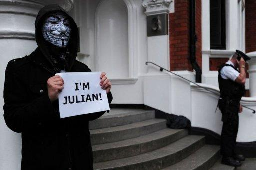 <p>A protester wearing a Guy Fawkes mask demonstrates outside the Ecuadorian embassy in London, on June 23, 2012, where Wikileaks founder Julian Assange is seeking political asylum. Assange Monday called for diplomatic guarantees he will not be pursued by the United States for publishing secret documents if he goes to Sweden to face criminal allegations.</p>