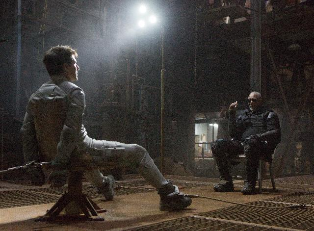 "This film publicity image released by Universal Pictures shows Tom Cruise, left, and Morgan Freeman in a scene from ""Oblivion."" (AP Photo/Universal Pictures)"