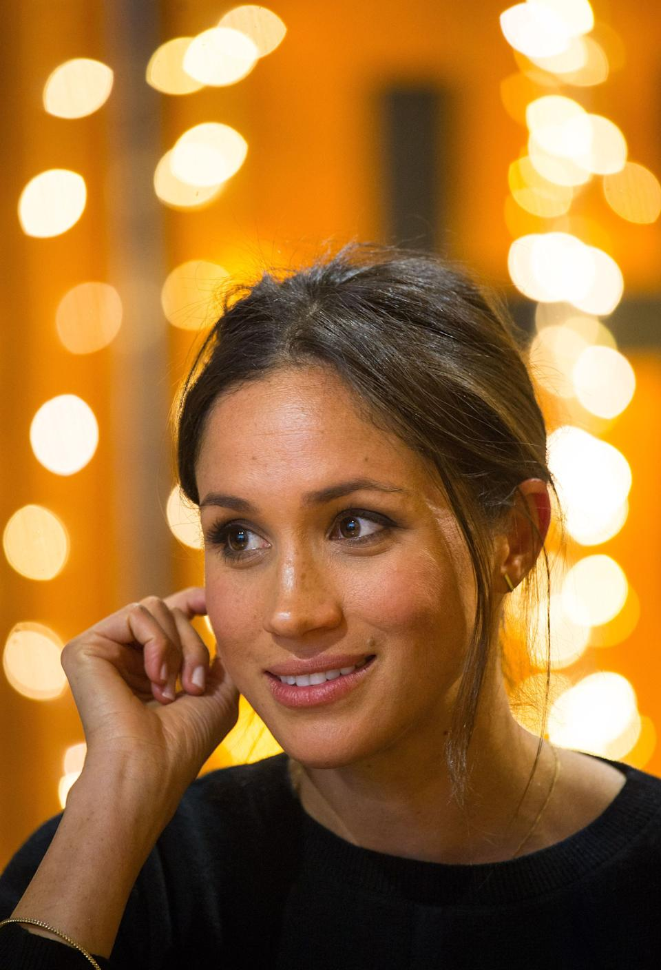 Britain's Prince Harry's fiancée, US actress Meghan Markle gestures during a visit to Reprezent 107.3FM community radio station in Brixton, south west London on January 9, 2018.   During their visit to the station, they met some of the presenters, content producers and staff, heard more about their training programmes, and met some of the current and former volunteers who have benefitted from the training. / AFP PHOTO / POOL / Dominic Lipinski        (Photo credit should read DOMINIC LIPINSKI/AFP via Getty Images)