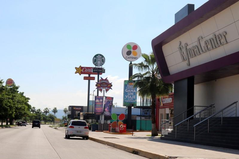 """A general view shows restaurants and coffee shops at the Tres Rios neighborhood, which faced the most intense firefights on the street where soldiers attempted to arrest Ovidio Guzman, a son of jailed drug lord Joaquin """"El Chapo"""" Guzman, in Culiacan"""