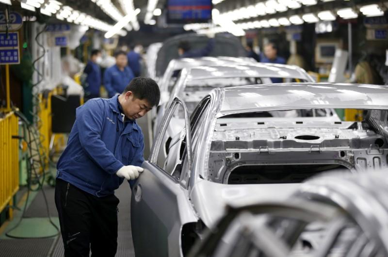 FILE PHOTO - A worker works at an assembly line of Hyundai Motor's plant in Asan