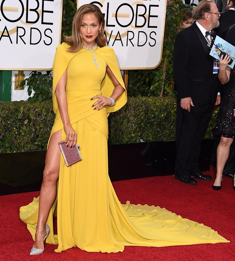 On a red carpet crowded with stunning looks, J. Lo still saves some of the attention for herself in a canary yellow gown paired with a dark red lip. While the dress — high slit, built-in cape — is classic J. Lo, it's the dark makeup that makes it a real step in her red carpet evolution. Jennifer Lopez in Giambattista Valli at the 73rd annual Golden Globes in Beverly Hills, California, January 2016. Photo by Getty Images.