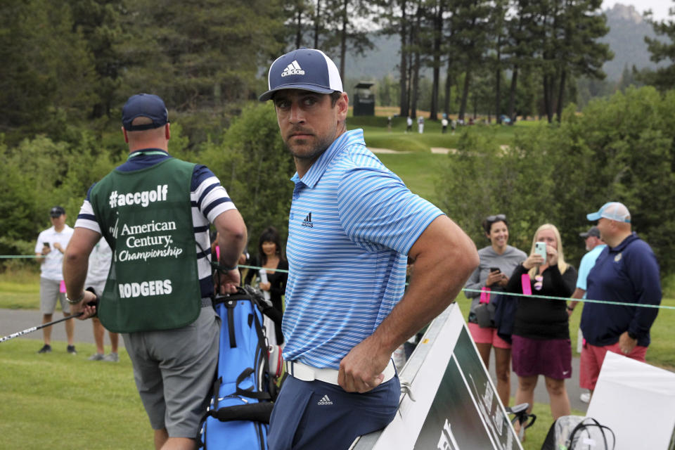 Aaron Rodgers is enjoying his offseason, which has included golf, swimming with sharks and meeting the Dalai Lama. (AP Photo/Lance Iversen)