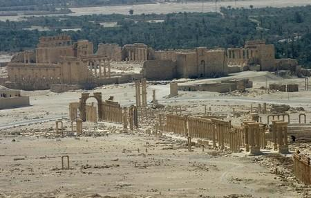 A general view shows the ancient Temple of Bel in the historical city of Palmyra, Syria, June 13, 2009. REUTERS/Gustau Nacarino