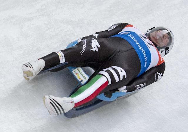Armin Zoeggeler of Italy speeds in the ice channel during the men's Luge World Cup race at the luge World Cup in Oberhof, Germany, Sunday, Jan. 12, 2014. (AP Photo/Jens Meyer)