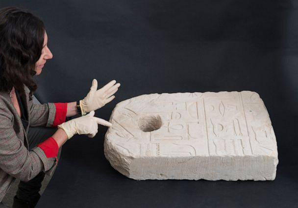 PHOTO: Shirly Ben Dor Evian points to the hands of Seshat, the Egyptian deity of writing, on the stone anchor discovered off Atlit. (Laura Lachman)