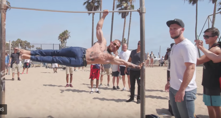 A Conor McGregor impersonator shows off his strength at Muscle Beach in Venice, California (YouTube).