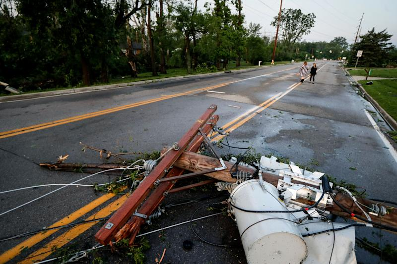 Debris from storm damage litters a residential neighborhood in Vandalia, Ohio, on May 28. (Photo: John Minchillo/AP)