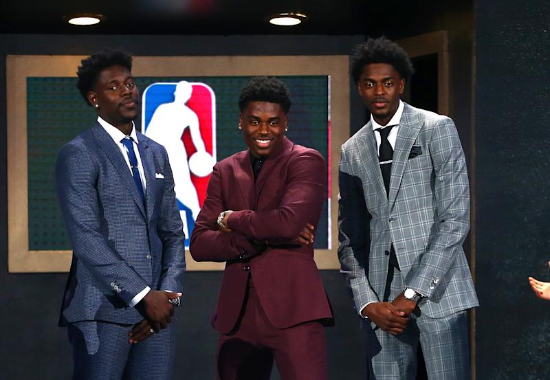 Aaron Holiday (center) poses with brothers Justin Holiday and Jrue Holiday during the 2018 NBA Draft at the Barclays Center on June 21, 2018.
