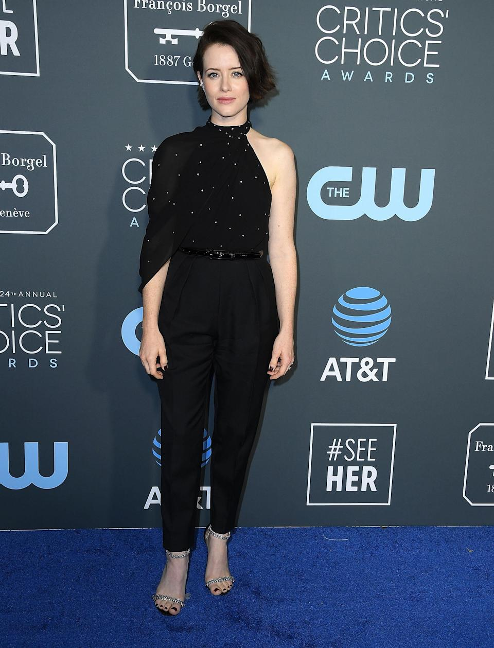 <p>The 'First Man' actress wore a Celine jumpsuit paired with Jimmy Choo sandals at the awards ceremony.<em> [Photo: Getty]</em> </p>