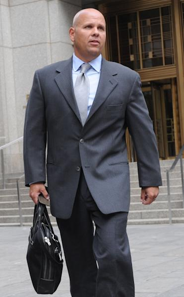FILE - In this June 21, 2011 file photo, George Perez, former computer programmer for Bernard L. Madoff Investment Securities, leaves Manhattan federal court in New York. Perez and four other back-office subordinates of the Ponzi king go to trial Tuesday, Oct. 8, 2013 as the government for the first time shows a jury what it has collected in its five-year probe of one of history's biggest frauds. (AP Photo/Louis Lanzano, File)