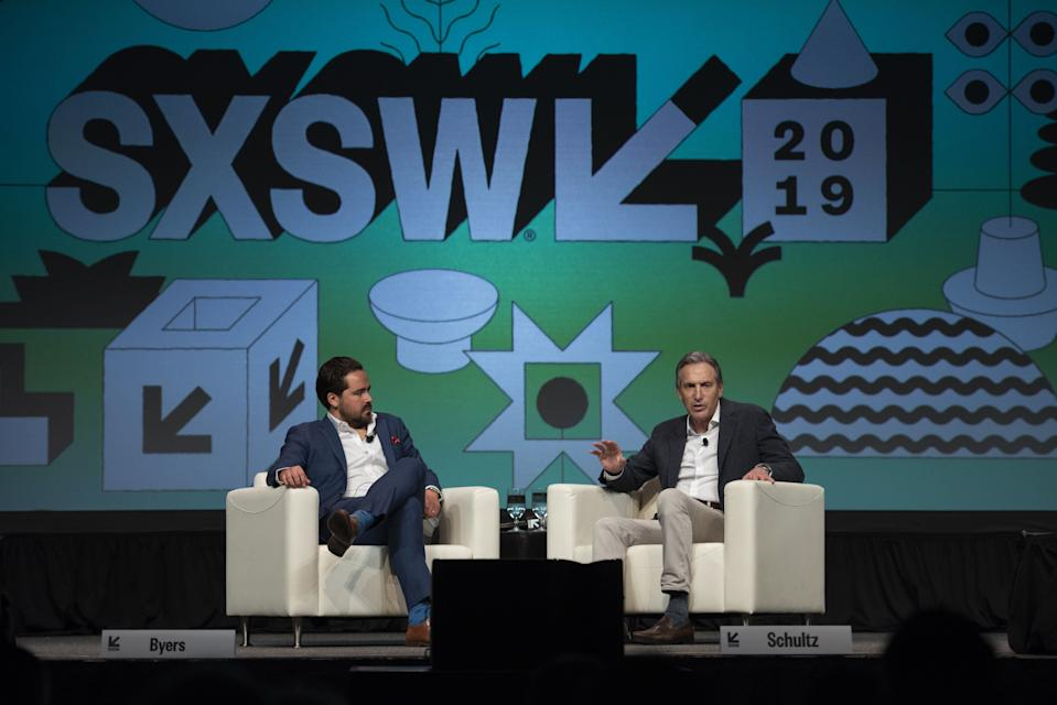Howard Schultz, former chief executive officer of Starbucks Corp., right, speaks as Dylan Byers, senior media reporter at NBC News, listens during the South By Southwest (SXSW) conference in Austin, Texas, U.S., on Saturday, March 9, 2019. The SXSW conference provides an opportunity for global professionals at every level to participate, network, and advance their careers. Photographer: Callaghan O'Hare/Bloomberg via Getty Images