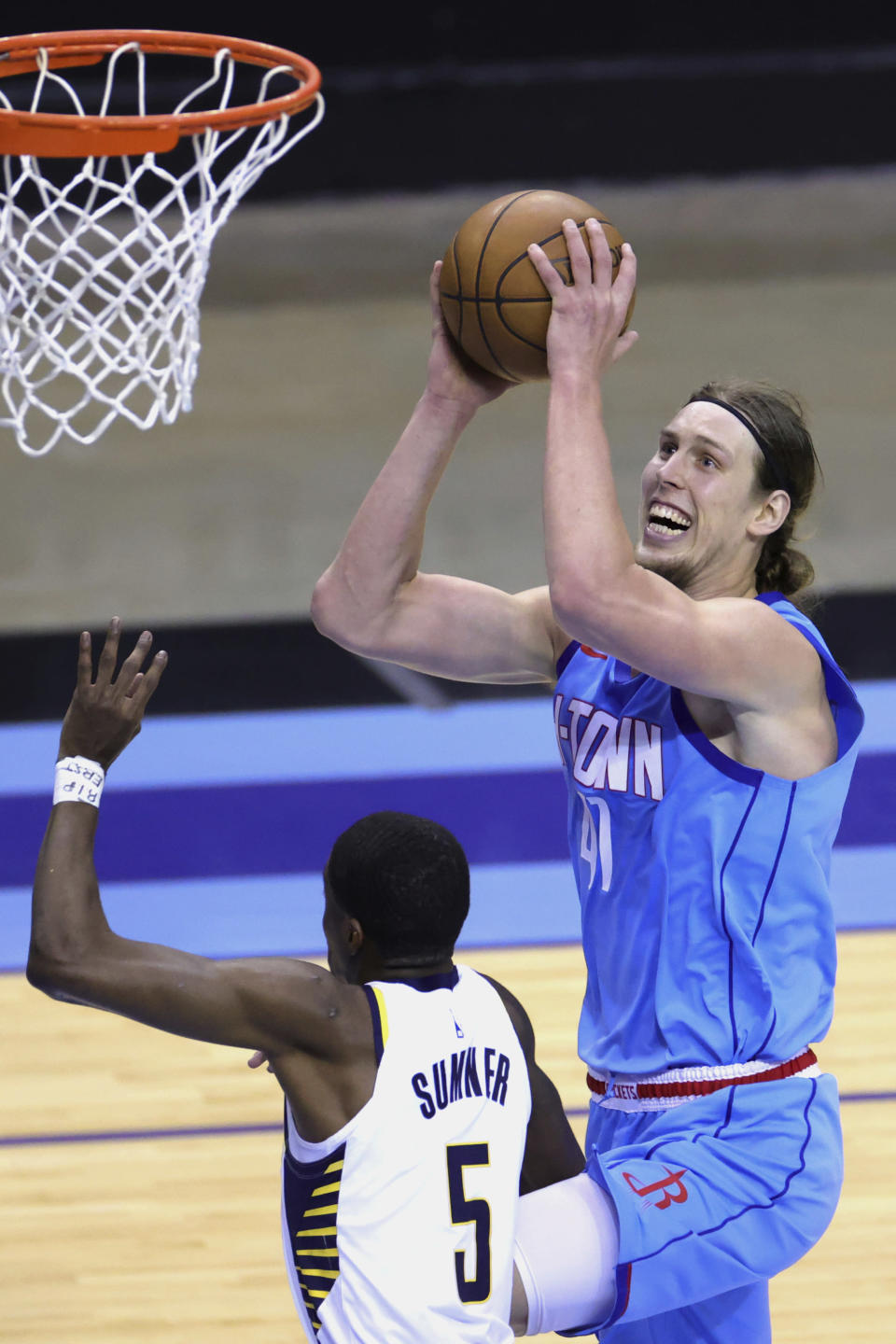Houston Rockets' Kelly Olynyk drives to the basket over Indiana Pacers' Edmond Sumner during the third quarter of an NBA basketball game Wednesday, April 14, 2021, in Houston. (Carmen Mandato/Pool Photo via AP)