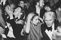 <p>Halston was a regular at New York's iconic Studio 54. He's pictured here at a New Year's Eve party with Bianca Jagger, Jack Haley, Jr., Liza Minnelli, and Andy Warhol.</p>