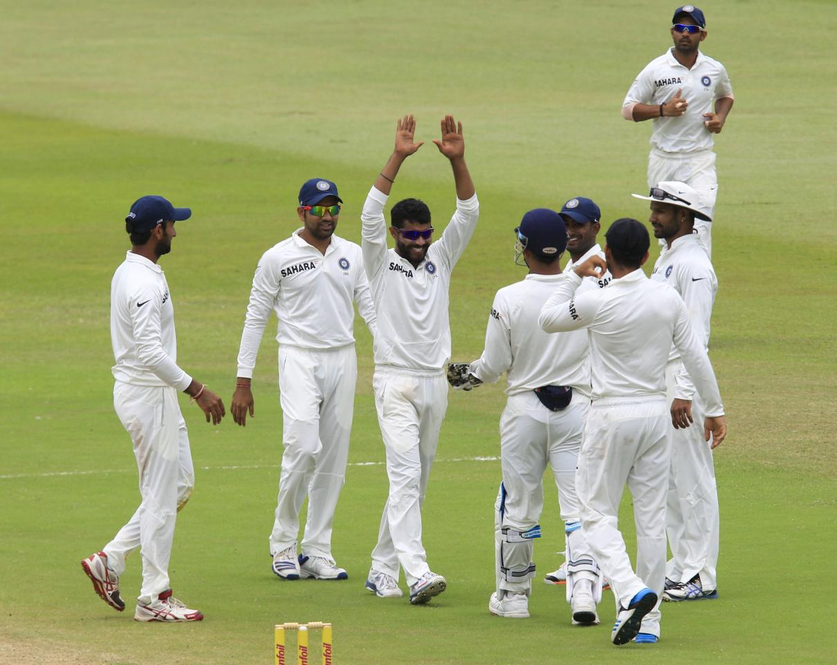 India celebrate the wicket of South Africa's Jacques Kallis during the fourth day of the second test cricket match in Durban, December 29, 2013. REUTERS/Rogan Ward (SOUTH AFRICA - Tags: SPORT CRICKET)